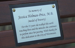 The bench in honour of Jessica Holman-Price has a dedication plaque. (CBC)